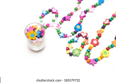 Kids beaded jewellery isolated on white