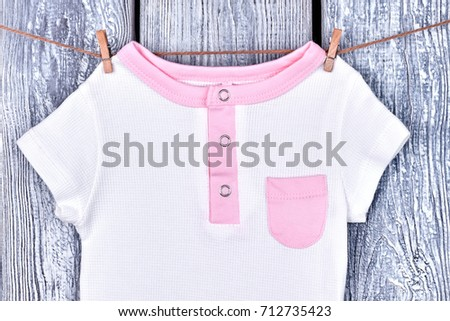 a6c0b521aa82 Kids beautiful t-shirt on rope. Infant girl organic bodysuit drying on  clothesline on