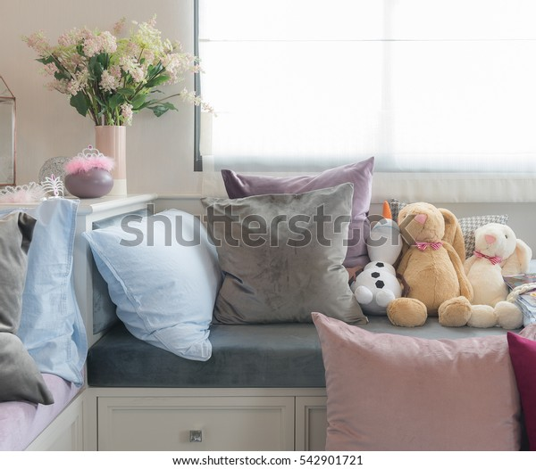 kid's bedroom with dolls and set of pillows, interior design