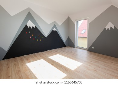 Kids bedroom with mountains paint and new laminated floor