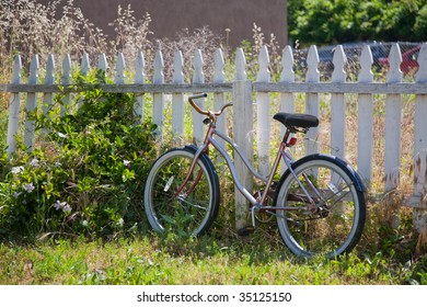 Kids Bike against picket fence
