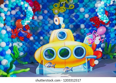 Kids birhtday party decorated with ballons sea concept and yellow submarine
