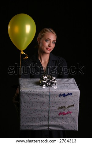 Kids Birthday Concepts A Young Mom Surprises Her Son Or Daughter With Large Present And Yellow Balloon
