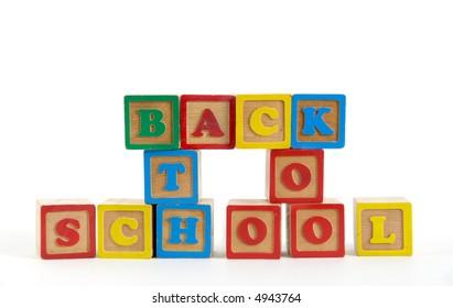 kids blocks spelling back to school on white background