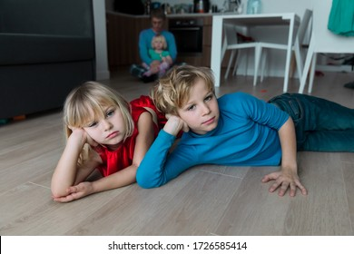 kids- boy and girl -bored staying home, family in stress