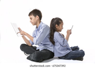 Kids boy and girl enjoy using smartphone or tablet computer isolate on white background, Concept of communication technology and people