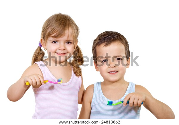Kids - boy and girl - with toothbrush - isolated