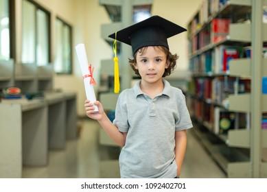 Kids Boy with Graduate Hat at Classroom Kids Preschool  - Achievement Successful Concept