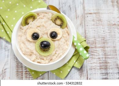Kids breakfast oatmeal porridge with fruits and nuts