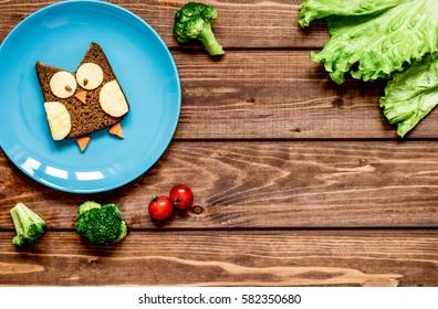 kids breakfast owl shaped sandwich on blue plate top view