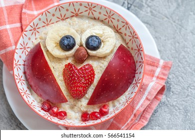 Kids breakfast porridge with fruits and nuts for Valentine day