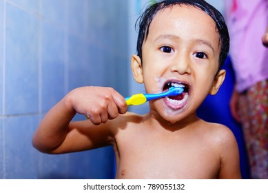 Kids Brush His Teeth In Bathroom , Hygiene Concept