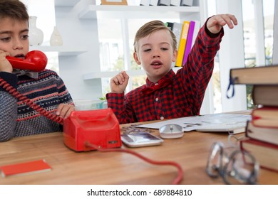 Kids as business executives working together in office