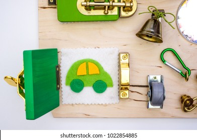 kids busy board with many things - Shutterstock ID 1022854885