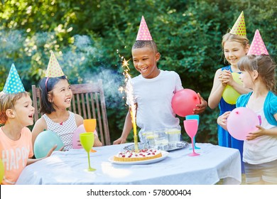 Kids celebrate together childrens birthday party with fireworks