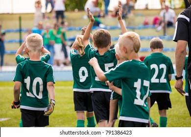 Kids Celebrating Soccer Victory. Young Boys Celebrating Soccer Game Win. Group of Happy Football Players After Final Match. Boys Celebrating Soccer Football Championship
