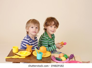 Kids, children cooking and playing with pretend food, sharing and nutrition concept