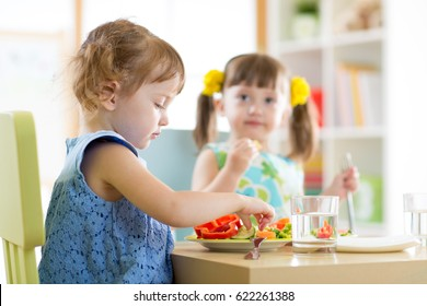 kids children eating vegetables in kindergarten, daycare or at home