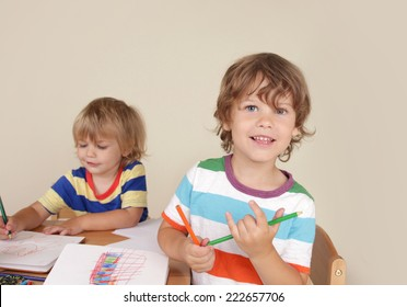 Kids, children engaged in art and craft with pencils and paper, learning and education concept