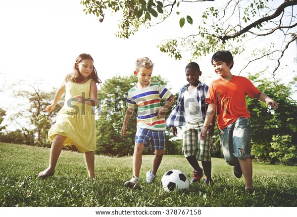 Kids Children Playing Football Fun Happiness Concept