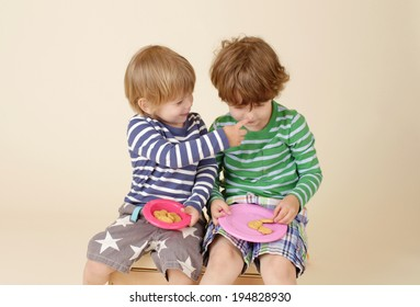 Kids, children sharing a snack, food, suitable for nutrition, eating, sharing, fashion concepts