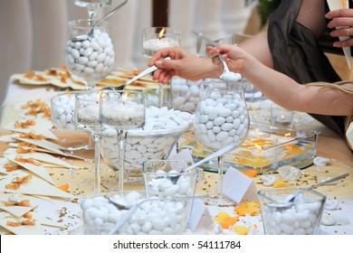 Kids choosing candies from wedding buffet