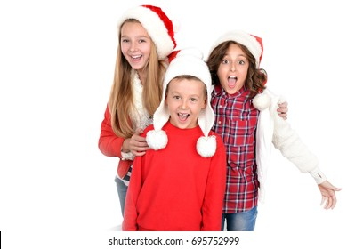 Kids in Christmas outfits posing happily
