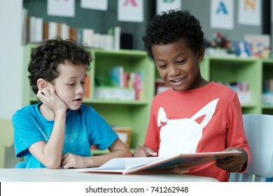 Kids in classroom, Happy diverse boy in reading class, American and african boys studying together with happiness in elementary school , kindergarten, kid preschool education concept