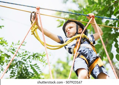 Kids climbing in adventure park.