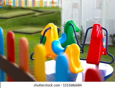 kids club or kinder garden horses carousel ride in colorful environment
