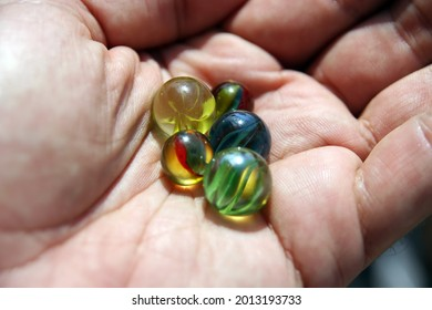Kids colorful Marbles. Playing Marbles. Vintage Kids Toy.