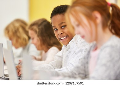 Kids in computer lessons learn online media literacy and computer science