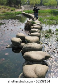 kids crossing stepping stones