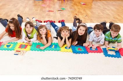 Kids crowd lying in line
