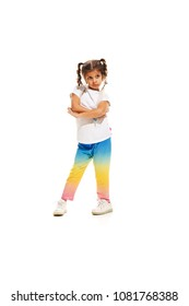 The kids dance school, ballet, hiphop, street, funky and modern dancers on white studio background. Happy girl is showing aerobic and dance element. Teen in hip hop style.