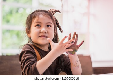 kids with dirty painted hand in art classroom