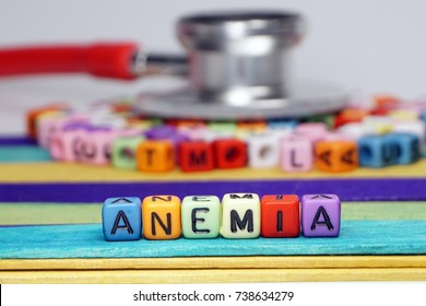 Kids disease concept. Colorful beads letter with word ANEMIA and stethoscope background