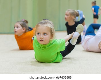 Kids doing exercise in gym
