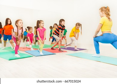 Kids doing gymnastic exercises in fitness class
