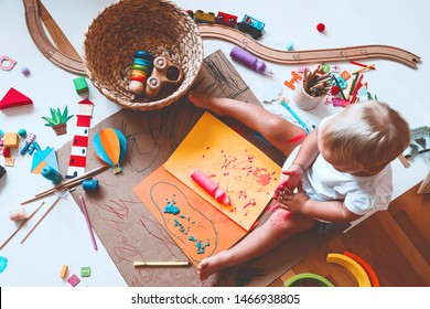Kids draw and make crafts. Children with educational toys and school supplies for creativity. Background for preschool and kindergarten or art classes. Boy and girl play at home or daycare