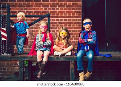 Kids dressed up as superheroes