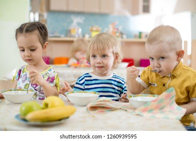 Kids eating in kindergarten or day care centre