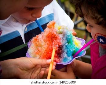 Kids eating ie shavings