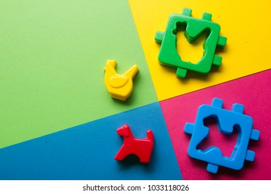 Kids educational developing toys frame on colorful background. Top view. Flat lay. Copy space for text