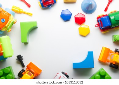 Kids educational developing toys frame on white background. Top view. Flat lay. Copy space for text
