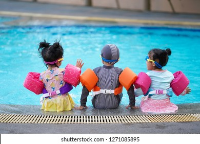Kids enjoy swimming at the swimming pool.summer vacation and holidays concept