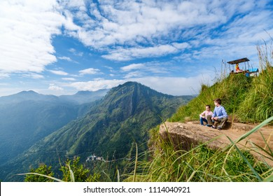 Kids enjoying breathtaking views over mountains and tea plantations from Little Adams peak in Ella Sri Lanka