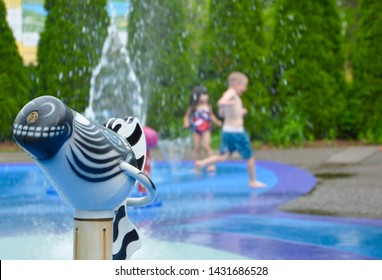 Kids enjoying their time at public splash pads