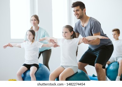 Kids exercising pilates on physcial education classes