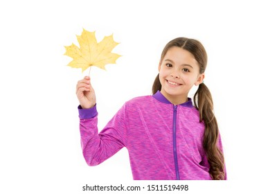 Kids fashion. Kid isolated on white show yellow leaf. Black friday concept. Autumn is second spring when every leaf is flower. Kid girl hold fallen maple leaf. Happy small child play with autumn leaf.